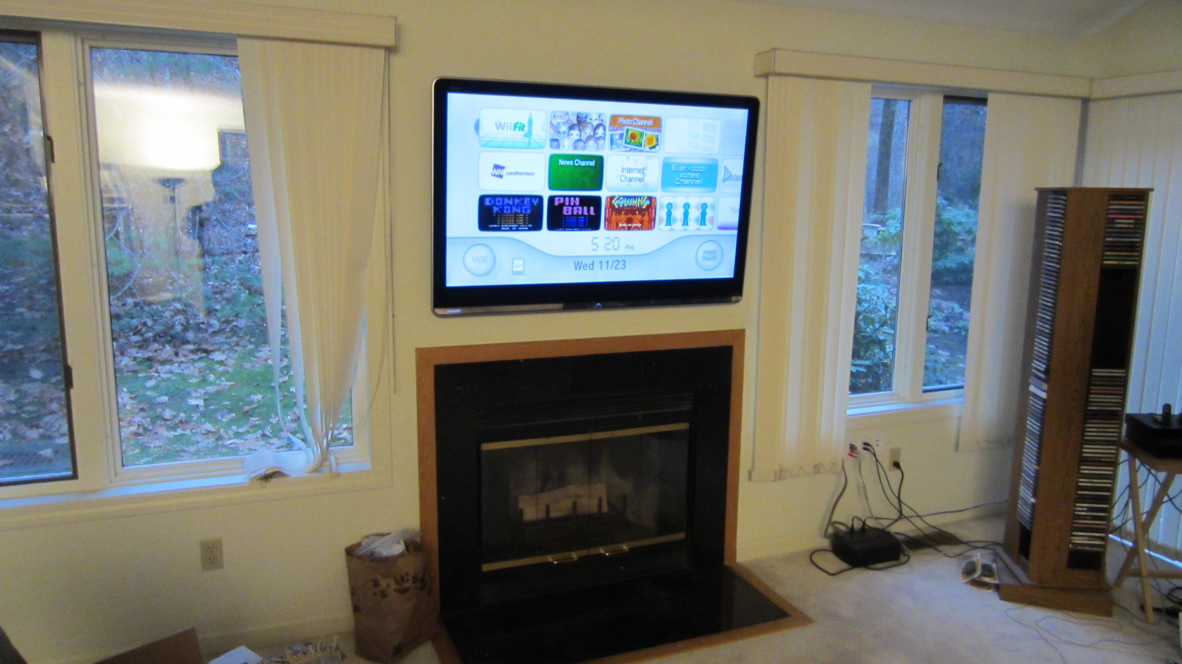 Bloomfield CT TV Mounted On Wall Above Fireplace Home Theater Installation