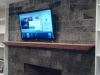 stone fireplace tv on wall