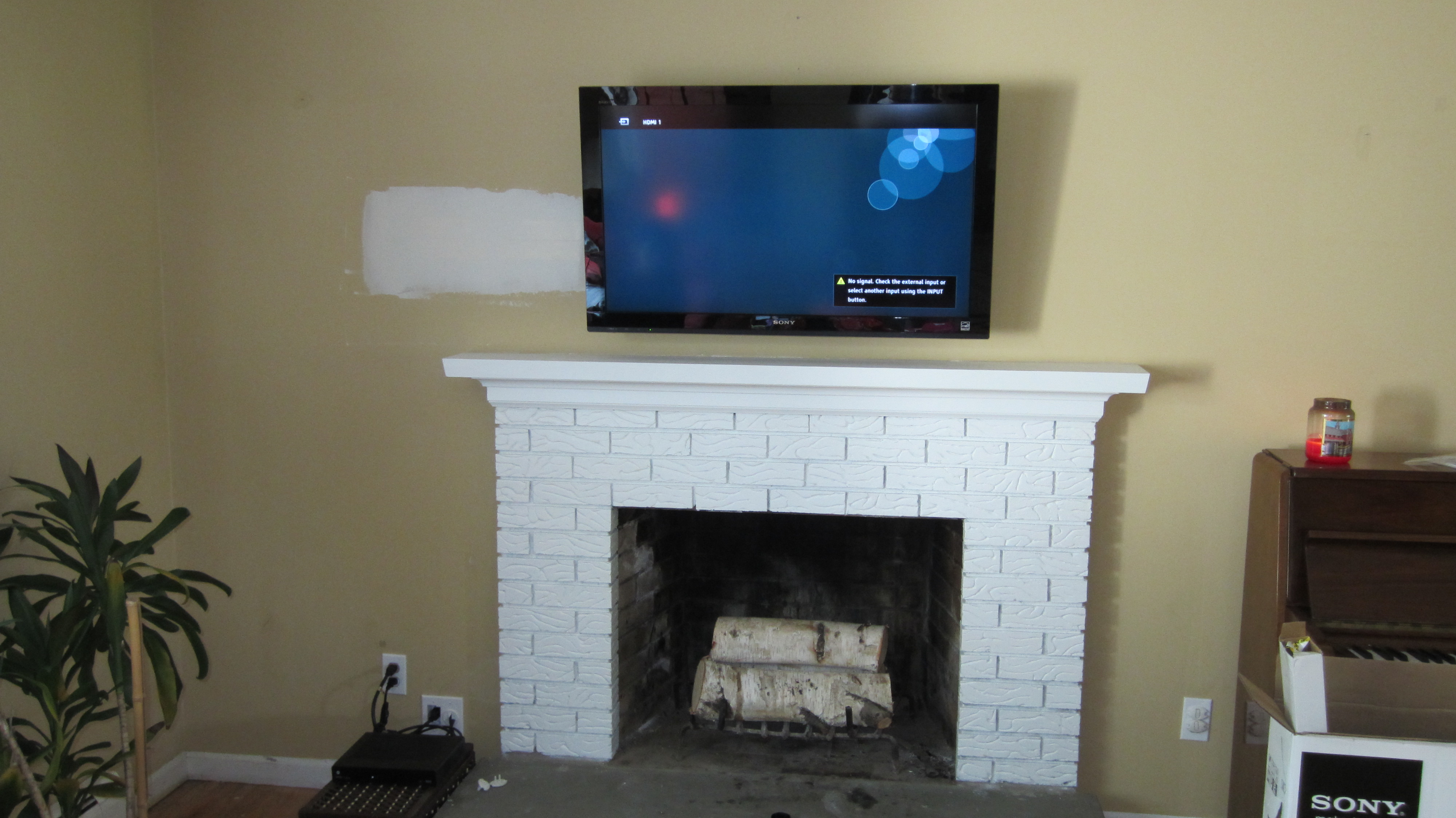CT – TV mounting over fireplace | Home Theater Installation