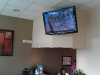 monroe-ct-tv-mounting-on-wall-in-office-3