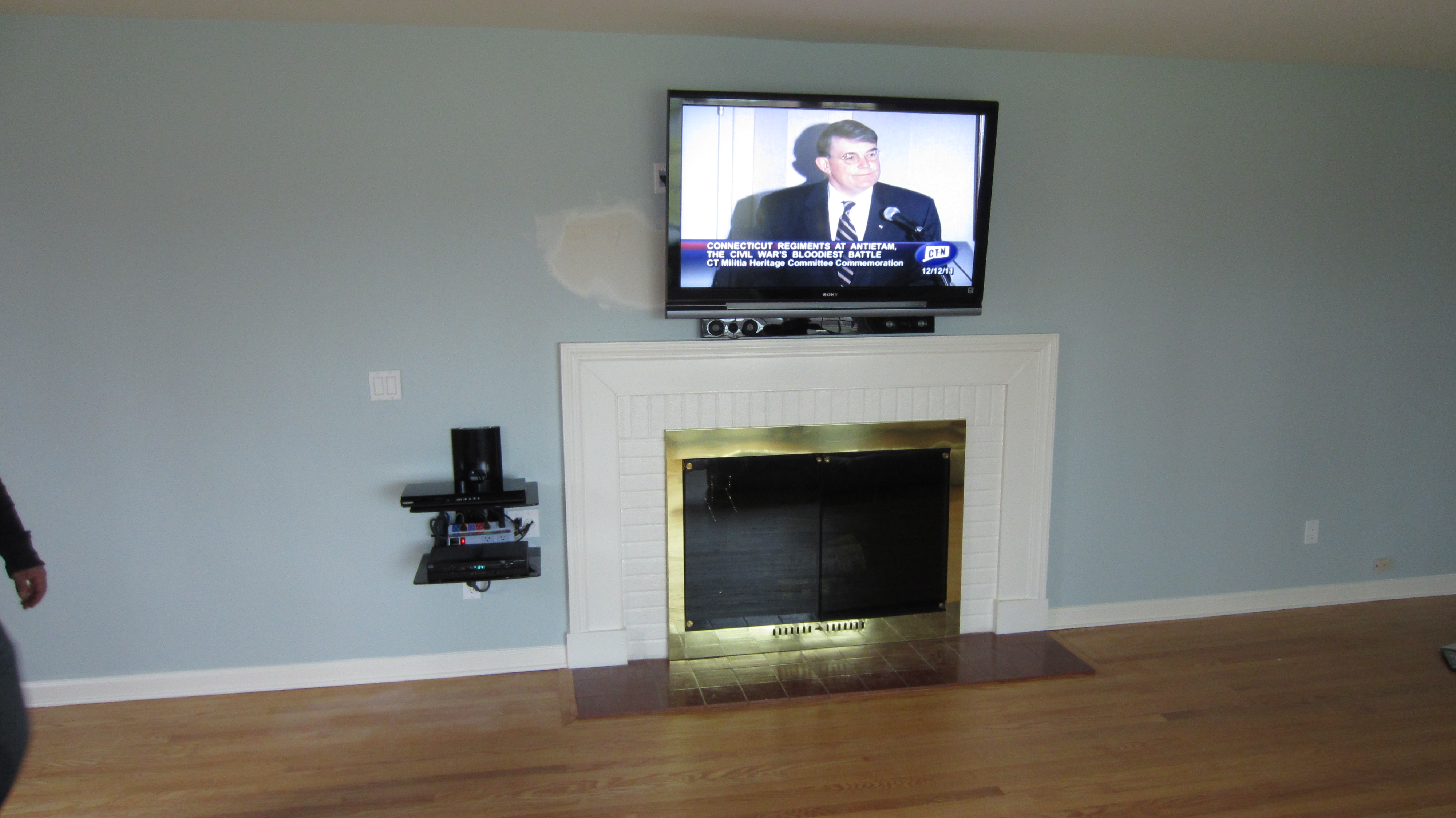 new-fairfield-ct-tv-mounting-over-fireplace-with-on-wall-shelf-and-in