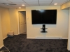 newington-ct-70-sharp-tv-installed-on-wall-with-our-black-media-shelf-and-all-wires-concealed-in-man-cave-1