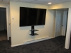 newington-ct-70-sharp-tv-installed-on-wall-with-our-black-media-shelf-and-all-wires-concealed-in-man-cave-2