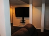 newington-ct-70-sharp-tv-installed-on-wall-with-our-black-media-shelf-and-all-wires-concealed-in-man-cave-3