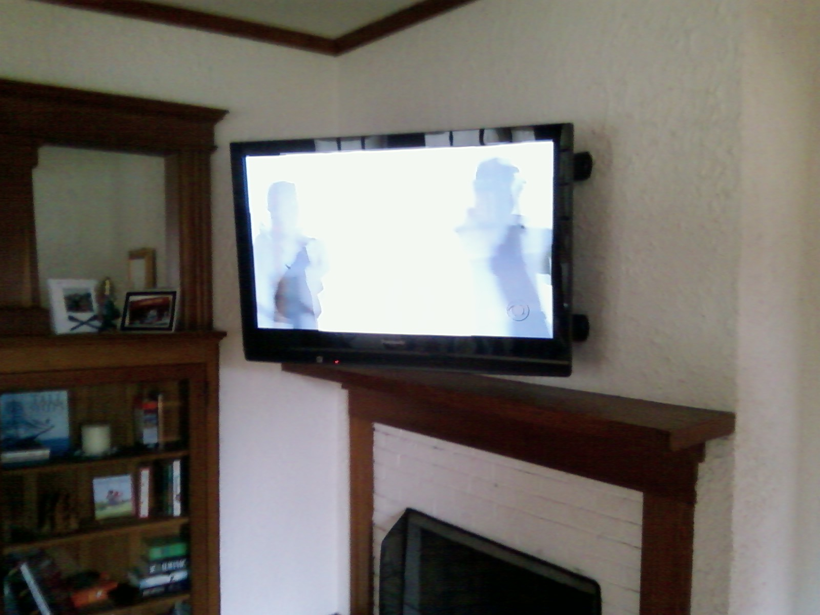 Tv Mounted Fireplace Hide Wires Tv Over The Fireplace Wall Tv