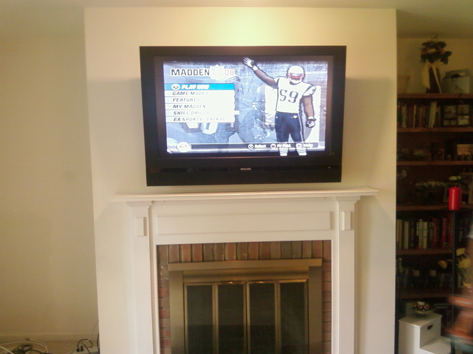 Tv above fireplace where to put cable box affordable flat for Tv over fireplace