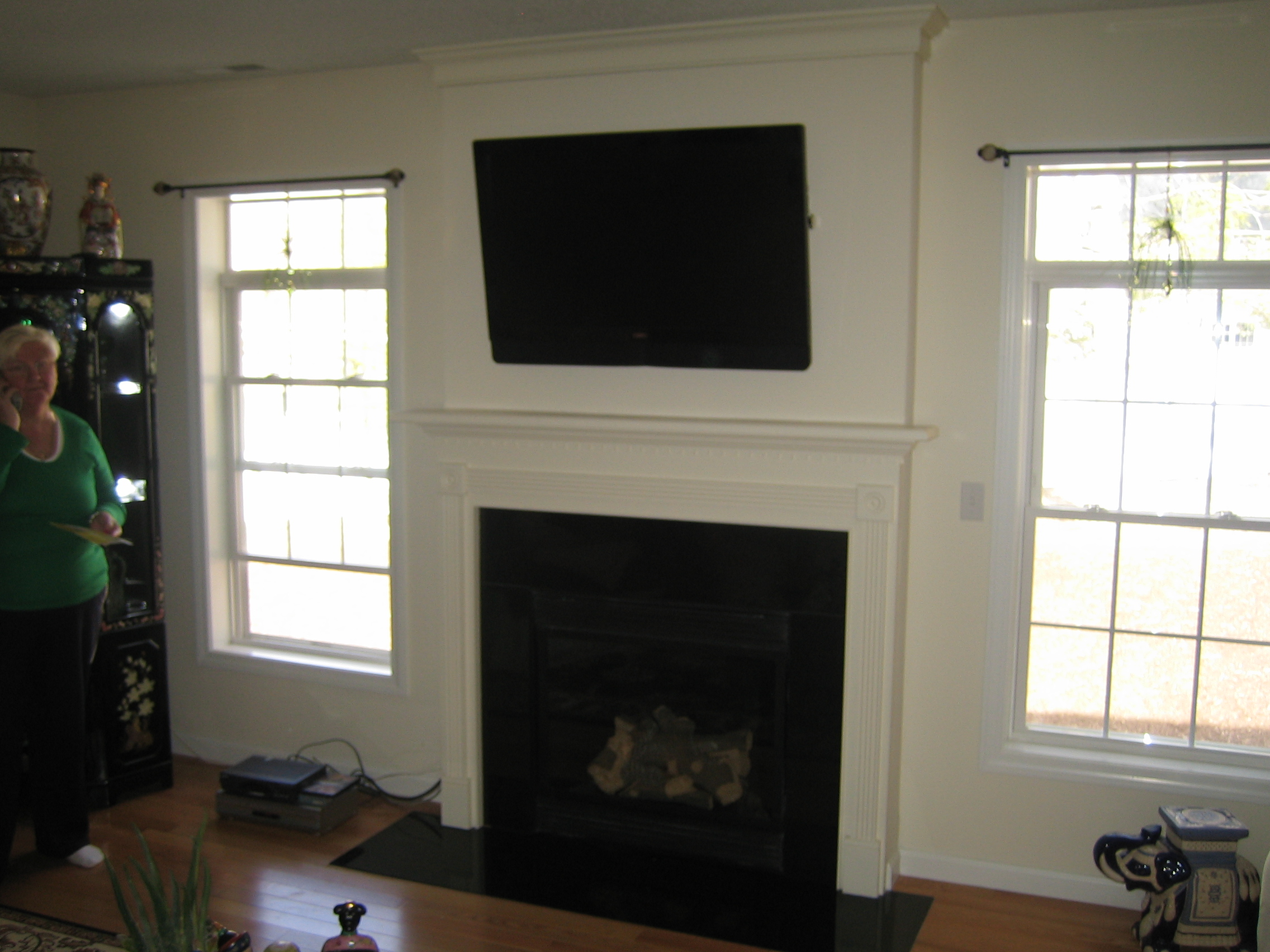 Woodbridge ct tv mounted over fireplace all wires hidden for Tv over fireplace