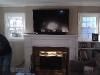 weathersfield-ct-tv-mounted-above-fireplace-with-soundbar-and-wires-down-the-side-3