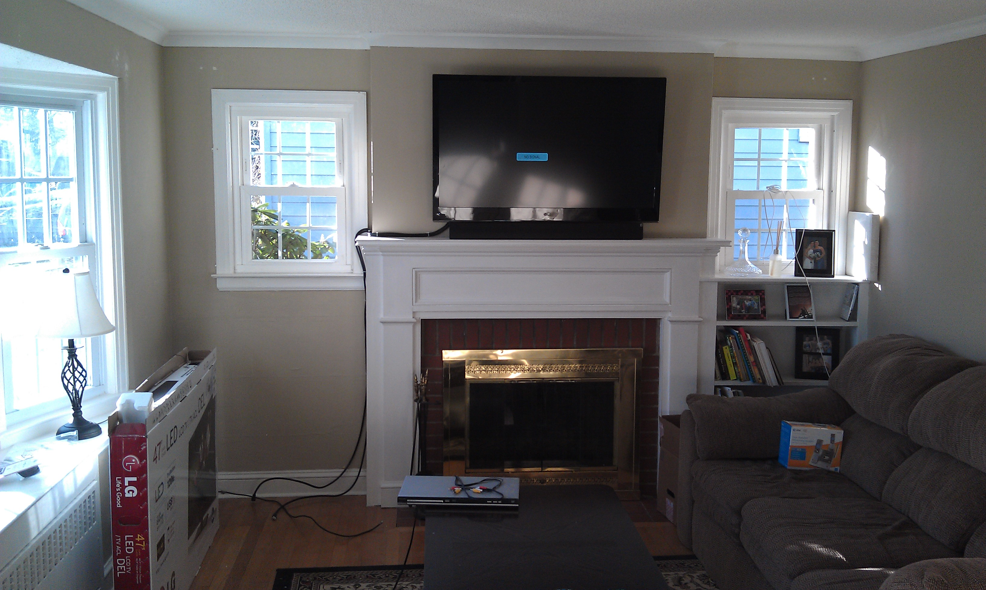 Wethersfield ct mount tv above fireplace home theater for Tv over fireplace