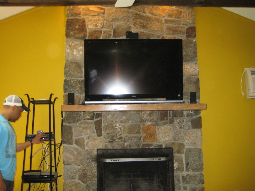 canaan ct tv install on natural stone above fireplace with surround sound richey group llc. Black Bedroom Furniture Sets. Home Design Ideas