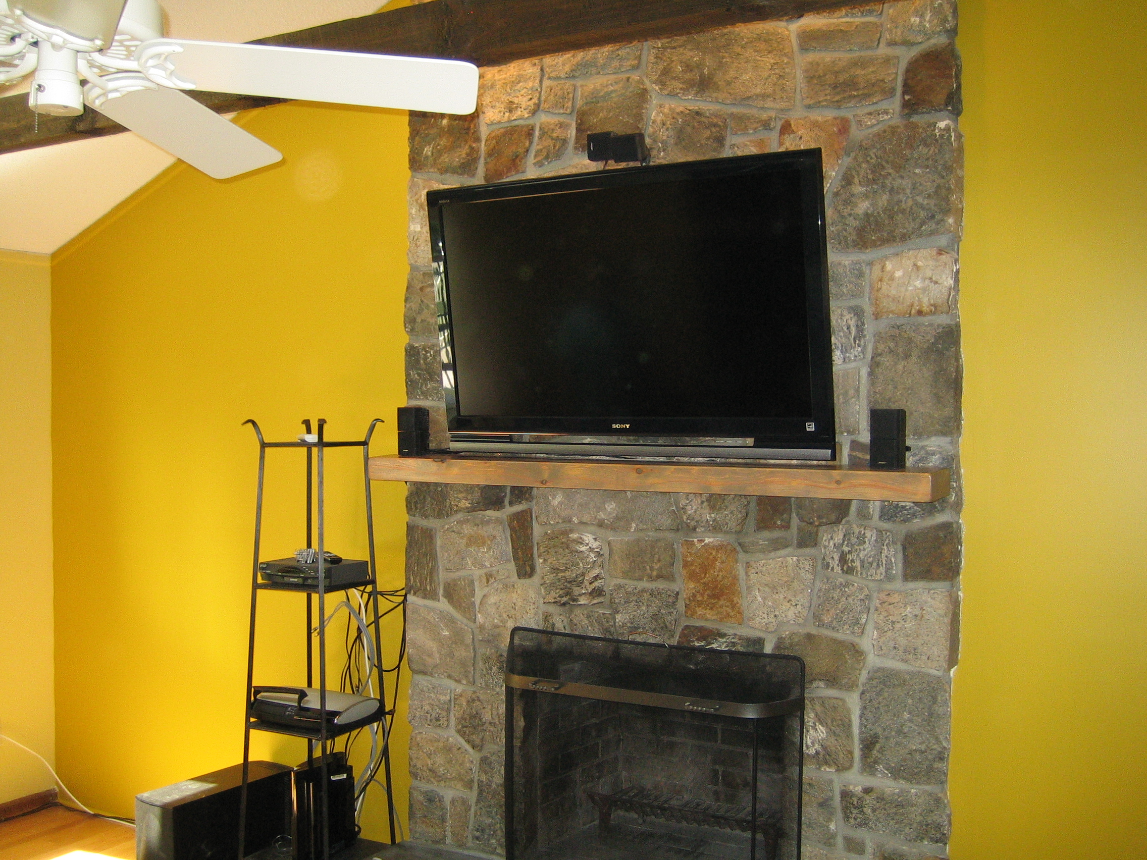 canaan ct tv install on natural stone above fireplace with surround sound home theater. Black Bedroom Furniture Sets. Home Design Ideas