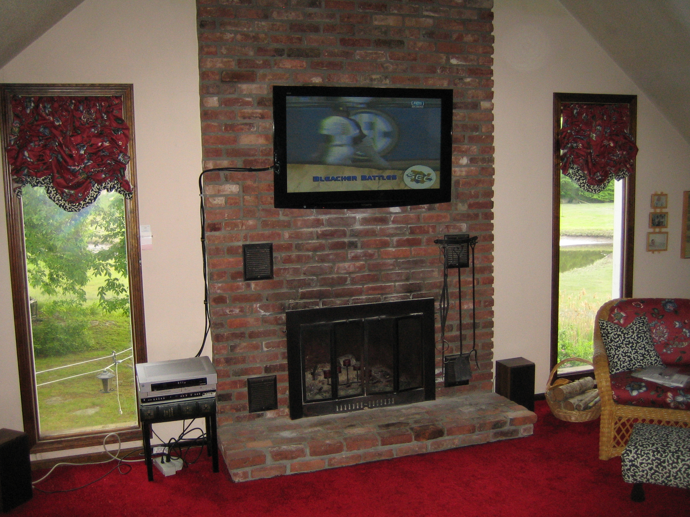 CT – TV mounted above fireplace on brick. looks amazing | Home Theater Installation