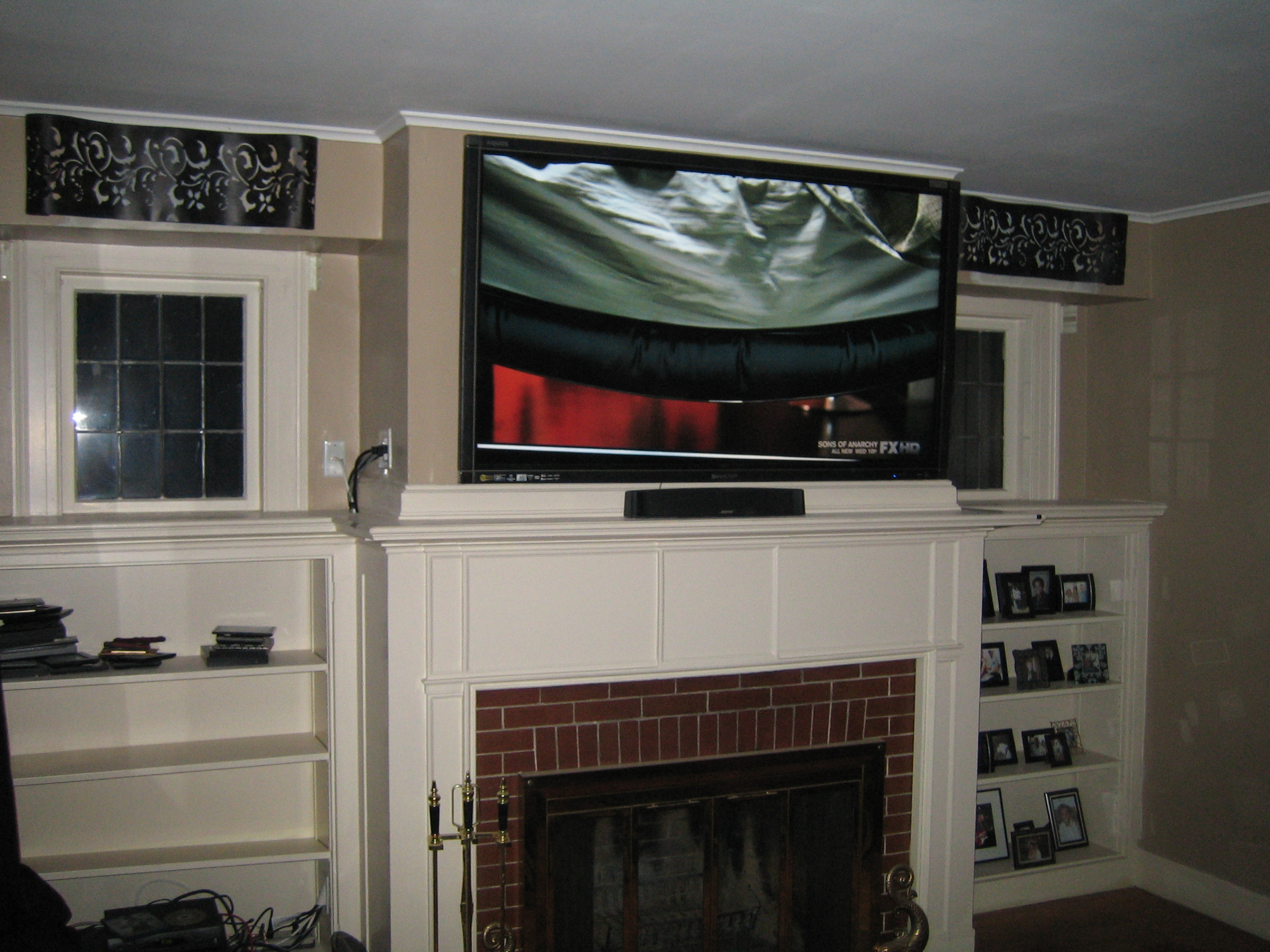 Cheshire ct mount tv above fireplace home theater installation for Installing in wall speakers on exterior wall